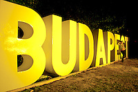 Participants take photos with the color light painted giant Budapest sign on Sziget festival held in Budapest, Hungary on August 11, 2011. ATTILA VOLGYI