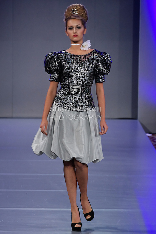 Model walks the runway in an outfit by Luis Machicao, for the Luis Machicao Couture Spring Summer 2012 fashion show, during Couture Fashion Week, Spring 2012.