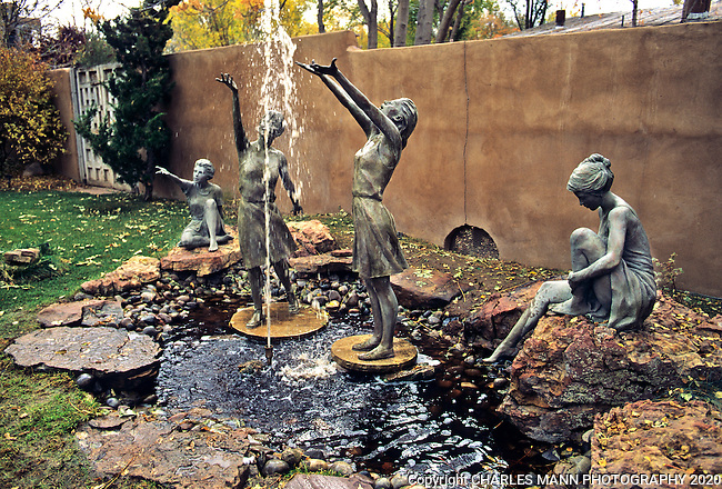 "The gardens of Santa Fe,New Mexico, offer a constant suppply of delightful surprises and artful delights. ""Nyads"" by Glenna goodacre is one of many sculptures in theh garden at the Nedra Mettucci Gallery."