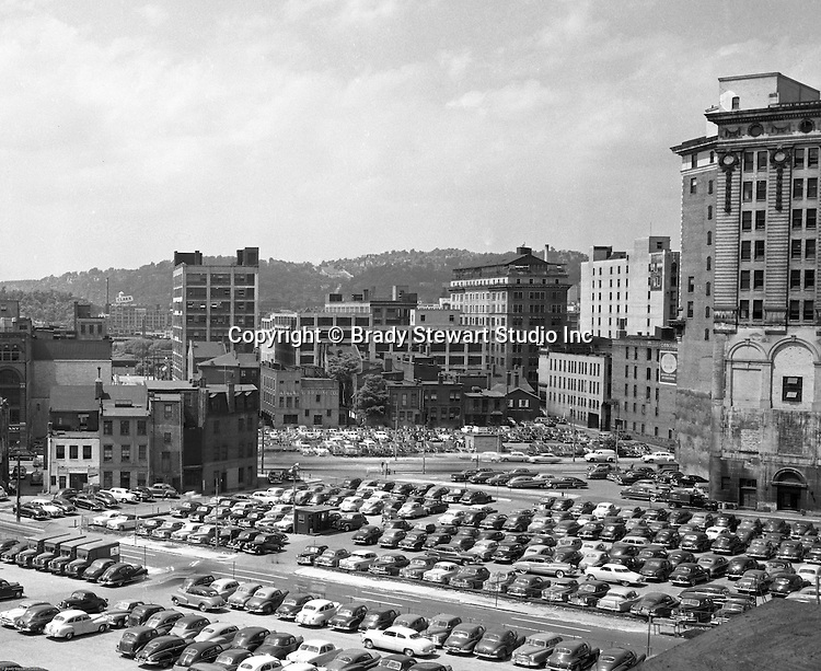 Pittsburgh PA:  View of the point area prior to the Gateway Center construction - 1949.  Eppy's parking lot at Liberty Avenue and Third Avenue in Pittsburgh.  Horne's Department Store in the Background. Company signs on the city buildings include: Robert L Brahm Company, Clark Candy Sign, Commonwealth Heating Company,