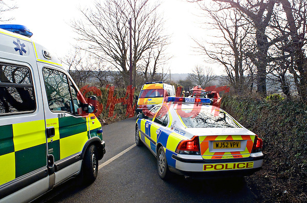 Paramedics and Police attend a RTC on a country lane UK. This image may only be used to portray the subject in a positive manner..©shoutpictures.com..john@shoutpictures.com