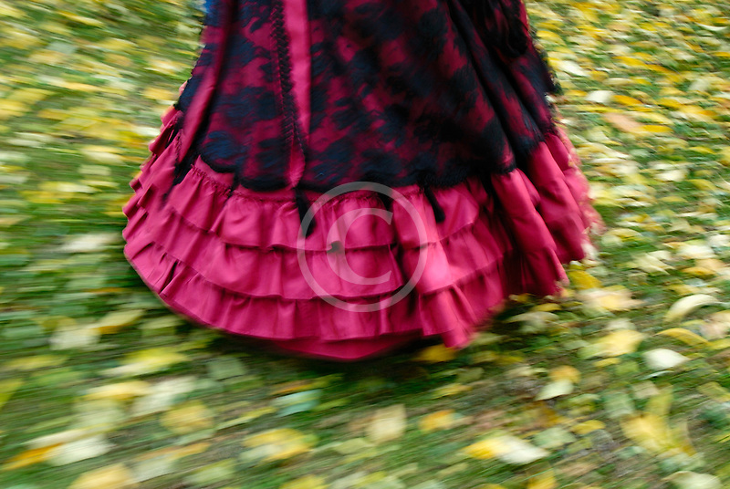 Canada, Montreal, Woman with Victorian dress walking on grass, partial view