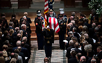 The Honor Guard carries the casket of former president George Herbert Walker Bush down the center isle following a memorial ceremony at the National Cathedral in Washington, Wednesday,  Dec.. 5, 2018. <br /> CAP/MPI/RS<br /> &copy;RS/MPI/Capital Pictures