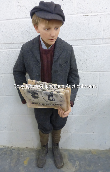 BNPS.co.uk (01202 558833)<br /> Pic: ChippenhamAuctionRooms/BNPS<br /> <br /> ***Please Use Full Byline***<br /> <br /> A newspaper boy. <br /> <br /> Henry VIII came face to face with his many wives at the Chippenham Auction Rooms in Wiltshire.A waxwork statue of Sir Winston Churchill has led a £20,000 sale of a bizarre assortment of lifelike figures of the great and the good.The life-size model of the wartime Prime Minister in his pomp sold for nearly £8,000 to a private individual who plans to put it in his living room for display.The next highest figure was that of a highly-realistic Henry VIII - and everyone of his six wives. The royal group sold for £3,600 to a television props company.Other waxworks that sold included a figure of a Chelsea Pensioner, Tom Thumb dressed as Napolean Bonarpate and Queen Alexandra.The figures were all sold by the owners of Yesterday's World, a provincial museum dedicated to British social history. The attraction, in Great Yarmouth, Norfolk, went out of business last November.