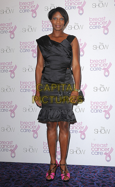DENISE LEWIS .Attending Breast Cancer Care's annual Fashion Show hosted by Gail Porter, Grosvenor House Hotel, London, England, UK,.7th October 2009..full length dress pink shoes sandals clutch bag open peep toe  black .CAP/BEL.©Tom Belcher/Capital Pictures.