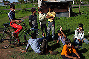 Village boys relax after playing kabbadi outside the school in village Gaura, outskirts of Bhopal, Madhya Pradesh, India.