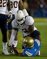 D.J. Holt of California tackles Jordon James of UCLA during the game at Rose Bowl in Pasadena, California on October 29th, 2011.  UCLA defeated California, 31-14.