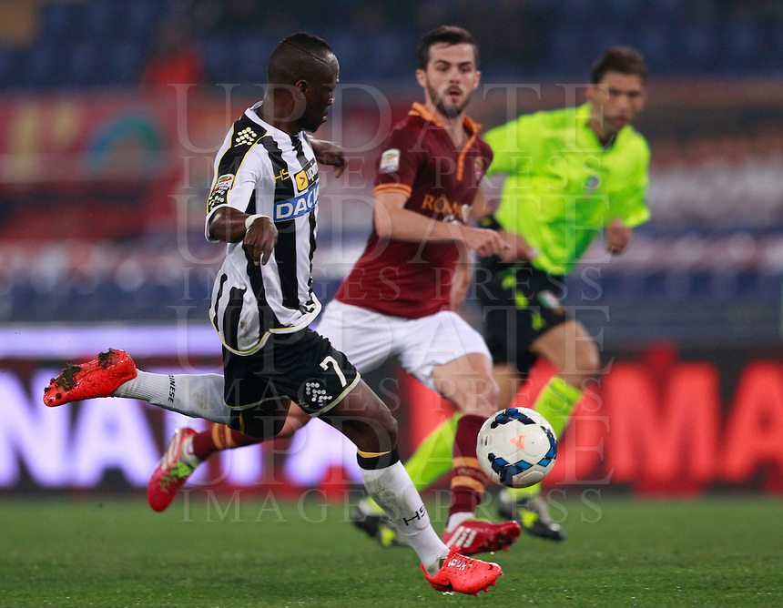 Calcio, Serie A: Roma vs Udinese. Roma, stadio Olimpico, 17 marzo 2014.<br /> Udinese midfielder Emmanuel Badu, of Ghana, left, is chased by AS Roma midfielder Miralem Pjanic, of Bosnia, during the Italian Serie A football match between AS Roma and Udinese at Rome's Olympic stadium, 17 March 2014.<br /> UPDATE IMAGES PRESS/Isabella Bonotto