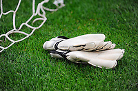 A pair of PUMA goalkeeper gloves lie in the grass next to the net. Sky Blue FC and the Los Angeles Sol played to a 0-0 tie during a Women's Professional Soccer match at Yurcak Field in Piscataway, NJ, on June 13, 2009.