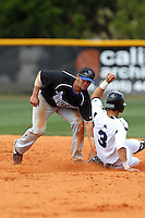 Brevard County CC Jordan Stampler #8 attempts to tag Andrew Rodriguez #3 sliding into second base during a game against Miami-Dade at Miami-Dade Community College on March 26, 2011 in Miami, Florida.  Photo By Mike Janes/Four Seam Images