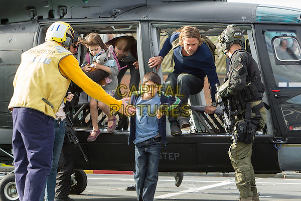 Sterling Jerins, Mireille Enos, Fabrizio Zacharee Guido &amp; Brad Pitt <br /> in World War Z (2013) <br /> *Filmstill - Editorial Use Only*<br /> CAP/FB<br /> Image supplied by Capital Pictures