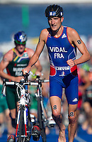 25 AUG 2013 - STOCKHOLM, SWE - Laurent Vidal (FRA) of France leaves transition for the start of the bike during the men's ITU 2013 World Triathlon Series round in Gamla Stan, Stockholm, Sweden (PHOTO COPYRIGHT © 2013 NIGEL FARROW, ALL RIGHTS RESERVED)