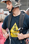 """Expression of the Spanish trade unions against cuts and closures of public services.A firefighter protest against cuts in public services in a shirt with the slogan """"Firefighters in danger of extinction""""..(Alterphotos/Ricky)"""