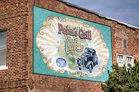 Palms Grill Cafe  Mural in Atlanta Illinois on Route 66.<br /> In its early days, weekly dances and bingo nights accompanied the blue-plate specials served at the Palms Grill Cafe. The  Grill  was also Atlanta s Greyhound bus stop. You just turned the light on above the door if you wanted the bus to pick you up. The Palms Grill Cafe served Atlanta s citizens, and a steady of Rt.66 travelers from 1934 until the late 1960s.&nbsp;<br /> <br /> In his design of the  Palms Grill Cafe  mural, Steve Estes of Possum Trot, Kentucky, captured the intent of the  Grill s   first owner, Robert Adams, an Atlanta native who named the cafe after a restaurant he frequented during trips to California.&nbsp;<br /> <br /> The mural was completed in June 2003 during the  LetterRip on Rt.66   gathering of approximately 100 Letterheads in Atlanta.