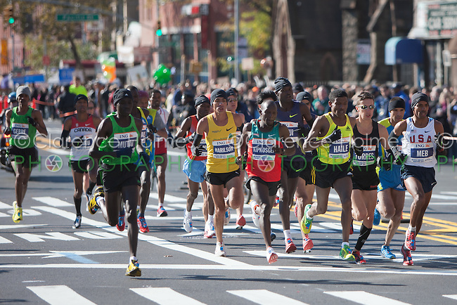 NEW YORK - NOVEMBER 7: The lead group of professional men, led by Haile Gebrselassie of Ethiopia, approaches the 8 mile mark on 4th avenue in the 2010 New York City Marathon.  Eventual race winner Gebre Gebrmariam also of Ethiopia was at the rear of the group at this point in the race.