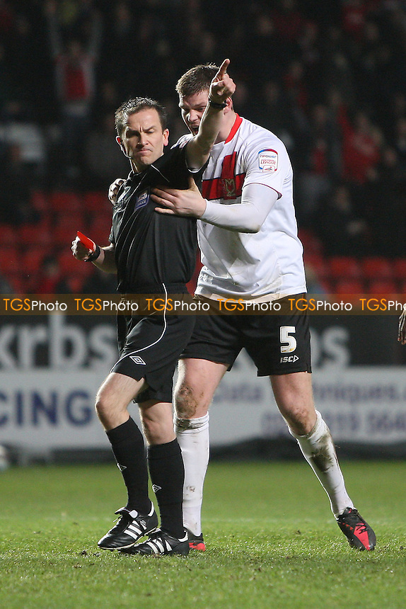 Gary MacKenzie of MK Dons protests to Referee Stroud after being sent off - Charlton Athletic vs MK Dons - nPower League One Football at The Valley, London - 14/02/12 - MANDATORY CREDIT: Gavin Ellis/TGSPHOTO - Self billing applies where appropriate - 0845 094 6026 - contact@tgsphoto.co.uk - NO UNPAID USE.