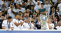 Calcio, finale di Champions League: Real Madrid vs Atletico Madrid. Stadio San Siro, Milano, 28 maggio 2016.<br /> Real Madrid&rsquo;s Cristiano Ronaldo, second from right, takes a selfie as hie teammate Pepe holds the Champions League trophy at the end of their final match against Atletico Madrid, at Milan's San Siro stadium, 28 May 2016. <br /> UPDATE IMAGES PRESS/Isabella Bonotto