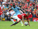 Marcus Rashford of Manchester United tussles with Bacary Sagna of Manchester City during the Premier League match at Old Trafford Stadium, Manchester. Picture date: September 10th, 2016. Pic Simon Bellis/Sportimage