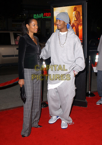 "GARCELLE BEAUVAIS-NILON & CHINGY.Paramount Pictures' L.A. Premiere of ""Coach Carter"" held at The Grauman's Chinese Theatre in Hollywood, California .January 13th, 2005 .full length grey gray checkered pattern trousers, black cardigan, traksuit jogging suit sweat suit, hand in pocket.www.capitalpictures.com.sales@capitalpictures.com.Supplied By Capital PIctures"