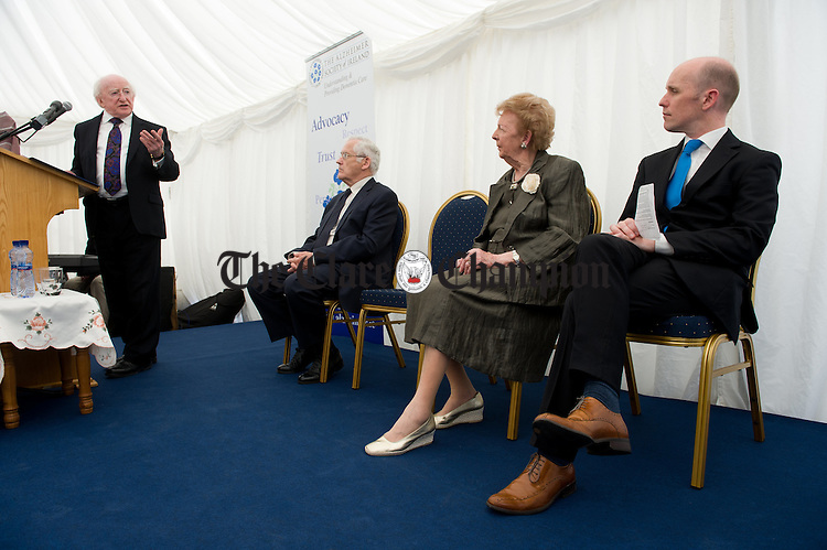 President Michael D Higgins addresses the gathering including Kevin Norton, chairman of the Alzheimers Society of Ireland, Lillian Sullivan, Director of the Alzheimers Society of Ireland and Dr. Henry O Connell, chairman of the Friends of Watermans Lodge, at the official opening of the Watermans Lodge day Care and Respite centre at Ballina. Photograph by John Kelly.