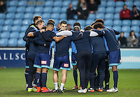 The Wycombe players come together after the match is delayed by 15 minutes before the The Checkatrade Trophy - EFL Trophy Semi Final match between Coventry City and Wycombe Wanderers at the Ricoh Arena, Coventry, England on 7 February 2017. Photo by Andy Rowland.