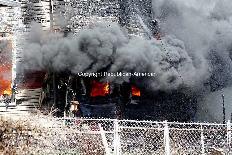 Waterbury, CT- 10 April 2014-041014CM01-  Flames engulf a multi-family home at 284 Hillside Ave. in Waterbury on Thursday. The two alarm fire destroyed the home and caused damage to nearby residences.     Christopher Massa Republican-American
