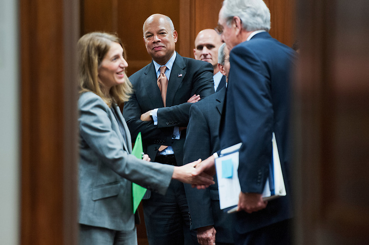 "UNITED STATES - NOVEMBER 12: HHS Secretary Sylvia Mathews Burwell, left, Homeland Security Secretary Jeh Johnson, center, and Sen. Tom Harkin, D-Iowa, talk in a holding room before a Senate Appropriations Committee hearing in Dirksen titled ""U.S. Government Response to the Ebola Outbreak,"" November 12, 2014. (Photo By Tom Williams/CQ Roll Call)"