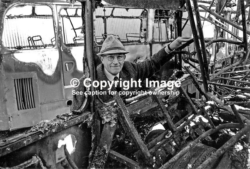 Mr Werner Heubeck, director, Ulsterbus and Citybus, among the wreckage of burnt-out buses at the company's Falls Road Depot, Belfast, N Ireland. Ref: 197701001..Copyright Image from Victor Patterson, 54 Dorchester Park, Belfast, UK, BT9 6RJ..Tel: +44 28 9066 1296.Mob: +44 7802 353836.Voicemail +44 20 8816 7153.Skype: victorpattersonbelfast.Email: victorpatterson@mac.com.Email: victorpatterson@ireland.com (back-up)..IMPORTANT: If you wish to use this image or any other of my images please go to www.victorpatterson.com and click on the Terms & Conditions. Then contact me by email or phone with the reference number(s) of the image(s) concerned.