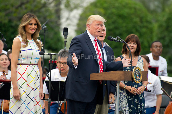 United States President Donald J. Trump makes remarks as he and first lady Melania Trump host the annual Congressional Picnic on the South Lawn of the White House in Washington, DC on Thursday, June 22, 2017.  From left to right: Melania Trump, President Prump, Vice President Mike Pence, and Karen Pence.<br /> Credit: Ron Sachs / CNP /MediaPunch