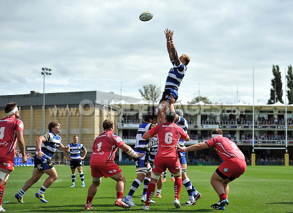 Dominic Day rises high to win lineout ball. Pre-season friendly match, between Bath Rugby and the Scarlets on August 16, 2014 at the Recreation Ground in Bath, England. Photo by: Patrick Khachfe / Onside Images