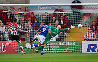 Macclesfield Town's Scott Wilson scores the opening goal as he puts the ball past Lincoln City's Matt Gilks<br /> <br /> Photographer Chris Vaughan/CameraSport<br /> <br /> The EFL Sky Bet League Two - Lincoln City v Macclesfield Town - Saturday 30th March 2019 - Sincil Bank - Lincoln<br /> <br /> World Copyright © 2019 CameraSport. All rights reserved. 43 Linden Ave. Countesthorpe. Leicester. England. LE8 5PG - Tel: +44 (0) 116 277 4147 - admin@camerasport.com - www.camerasport.com