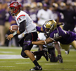 San Diego State quarterback Ryan Katz  tries to get away from Washington linebacker Cyler Crichton in a college football game at CenturyLink Field in Seattle, Washington on September 1, 2012  The Huskies beat the Aztecs 21-12.  © 2012. Jim Bryant Photo. All Rights Reserved.