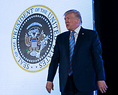 July 23, 2019 - Washington, DC, United States: United States President Donald J. Trump makes remarks at Turning Point USA's Teen Student Action Summit 2019. Trump is standing next to a doctored Presidential Seal on his arrival.<br /> Credit: Chris Kleponis / Pool via CNP