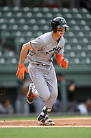 Third baseman Jacob Gonzalez (18) of the Augusta GreenJackets runs out a batted ball in a game against the Greenville Drive on Wednesday, April 25, 2018, at Fluor Field at the West End in Greenville, South Carolina. Augusta won, 9-2. (Tom Priddy/Four Seam Images)