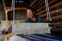 CHINA Yunnan Lugu Lake , ethnic minority Mosuo who are buddhist and women have a matriarch / CHINA Provinz Yunnan , ethnische Minderheit Mosuo am Lugu See , die Mosuo sind Buddhisten und Mosuo Frauen ueben ein Matriarchat aus, Haus von Frau Zhi Ma im Dorf Nisai