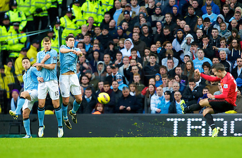 09.12.2012 Manchester, England. Manchester United's Dutch forward Robin Van Persie scores the winner from this free kick as Manchester City's Bosnian midfielder Edin Dzeko an team mates are beaten during the Premier League game between Manchester City and Manchester United from the Etihad Stadium. Manchester United scored the late winner to take the game 2-3.