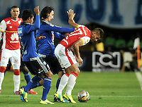 BOGOTA - COLOMBIA -14 -03-2015: Javier Reina (Izq.) y Rafael Robayo (Cent.) jugadores de Millonarios disputan el balón con Juan Roa (Der.) jugador de Independiente Santa Fe, durante partido entre Millonarios e Independiente Santa Fe por la fecha 10 de la Liga Aguila I-2015, jugado en el estadio Nemesio Camacho El Campin de la ciudad de Bogota. / Javier Reina (L) and Rafael Robayo (C) players of Millonarios vie for the ball with Juan Roa (R) player of Independiente Santa Fe, during a match between Millonarios and Independiente Santa Fe, for the  date 10 of the Liga Aguila I-2015 at the Nemesio Camacho El Campin Stadium in Bogota city, Photo: VizzorImage / Luis Ramirez / Staff.
