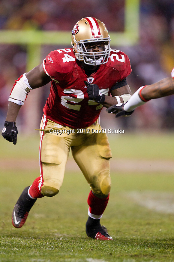 San Francisco 49ers running back Anthony Dixon (24) rushes the punter during an NFC Championship NFL football game against the New York Giants on January 22, 2012 in San Francisco, California. The Giants won 20-17 in overtime. (AP Photo/David Stluka)