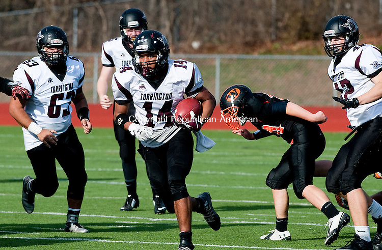 WATERTOWN, CT--- -112265JS06-Torrington's Newton Frias  (14) runs for a first down during their Thanksgiving day game against Watertown Thursday at Watertown High School. <br /> Jim Shannon Republican-American