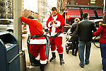 NEW YORK, NY - DECEMBER 15: Revelers dressed as Santa Claus during the annual SantaCon event December 15, 2012 in New York City. (Photo by Donald Bowers)