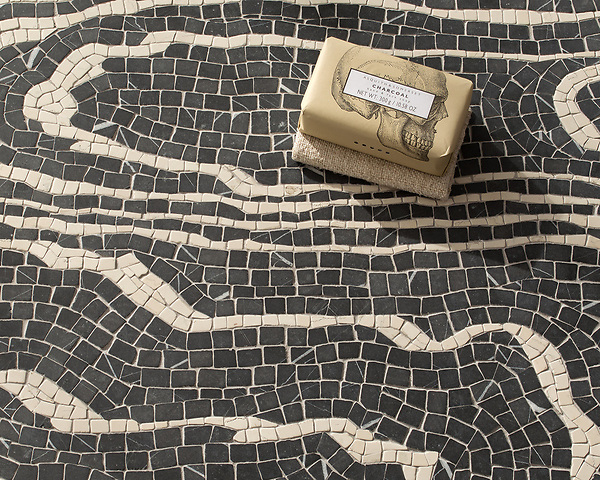 Mlima, a hand-chopped stone mosaic, shown in tumbled Saint Laurent and Bianco Antico. Designed by Joni Vanderslice as part of the J. Banks Collection for New Ravenna.
