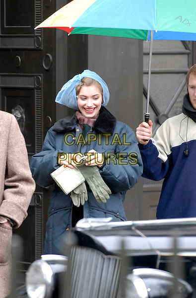 "IMOGEN POOTS.Filming ""Me and Orson Welles"", Victoria House, Bloomsbury, London, England..March 24th, 2008.on the set of half length blue plastic bag on head blue coat green gloves .CAP/IA.©Ian Allis/Capital Pictures."