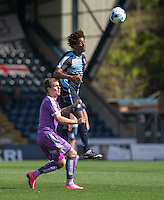 Sido Jombati of Wycombe Wanderers beats Gregg Wylde of Plymouth Argyle to the ball during the Sky Bet League 2 match between Wycombe Wanderers and Plymouth Argyle at Adams Park, High Wycombe, England on 12 September 2015. Photo by Andy Rowland.