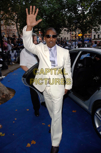 """JAMIE FOXX.European film premiere""""Miami Vice"""".Odeon cinema Leicester Square.27th July 2006 in London, England.Ref: FIN.full length white suit car sunglasses shades hand waving.www.capitalpictures.com.sales@capitalpictures.com.©Steve Finn/Capital Pictures."""
