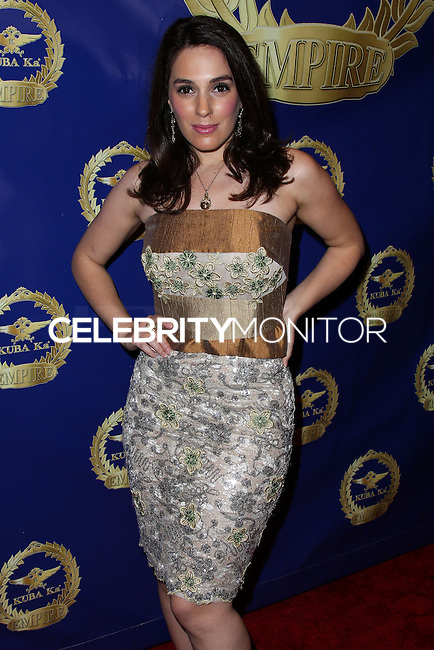 BEVERLY HILLS, CA, USA - MARCH 28: Christina DeRosa at the Versace Unveiling Of The 1st Pop Recording Artist Superhero - KUBA Ka's Performance Outfits. Designed by the legendary fashion hosuse - Donatella Versace. For the Benefit of the Face Forward Foundation (Plastic Surgery for Destroyed Faces from Violence). Pop entertainer TV personality KUBA Ka, together with VERSACE, unveiled Kuba Ka's new Versace images, for the First Pop Artist/Superhero of the World. He has become the inspiration of Donatella's newest and wildest creations and will celebrate the launch of his new power house conglomerate - KUBA Ka Empire Inc. in collaboration with the sensational fashion house - VERSACE on Friday, his birthday at a red carpet media and celebrity event at the luxurious Peninsula Hotel in Beverly Hills held at the Peninsula Hotel on March 28, 2014 in Beverly Hills, California, United States. (Photo by Xavier Collin/Celebrity Monitor)