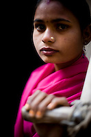 22 year old Aarti Devi, a member of the 'Gulabi Gang' (Pink Gang). In the badlands of Bundelkhand, one of the poorest parts of one of India's most populous states, a gang of female vigilantes have sprung up to fight the oppression of a caste-ridden, feudalistic and male dominated society. In a land where dowry demands and domestic and sexual violence are common, the 'Gulabi Gang', so called for their uniform of shocking pink saris, are picking up their lathis to fight against corruption and violence against women.