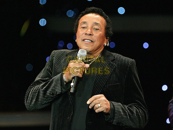 SOMKEY ROBINSON.Smokey Robinson Joins Human Nature to celebrate their 1 year anniversary at the Imperial Palace Hotel and Casino, Las Vegas, Nevada, USA, .11th  May 2010..half length  black velvet   pinstripe striped jacket hand microphone singing on stage musical music .CAP/ADM/MJT.© MJT/AdMedia/Capital Pictures.