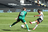 18th July 2020; Craven Cottage, London, England; English Championship Football, Fulham versus Sheffield Wednesday; Bobby Reid of Fulham shoots and scores for 5-3 in the  91st minute