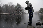 Dan Parks, of Waterville, Maine, braves the snow and cold to try his luck in Great Pond in Belgrade Lakes, Maine, during the first days of the 2006 fishing season.