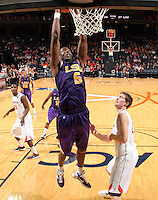 Jan. 2, 2011; Charlottesville, VA, USA; LSU Tigers forward Malcolm White (5) dunks the ball in front of Virginia Cavaliers forward Will Sherrill (22) during the game at the John Paul Jones Arena. Virginia won 64-50. Mandatory Credit: Andrew Shurtleff-